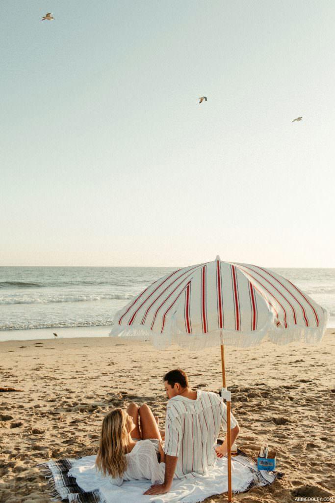boho beach umbrella modelo's on the beach engagement